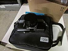 A cased Praktika camera