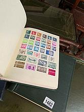 3 albums of stamps