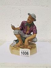 A Royal Doulton figurine, HN2487 'Beachcomber'