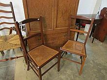 A pair of mahogany hall chairs with cane seats