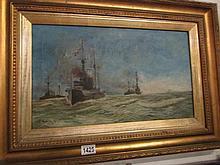 A gilt framed oil on canvasof 3 naval battleships signed A Eyles