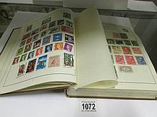 2 albums of stamps