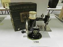 A Singer Child's sewing machine in original box