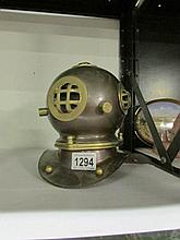 A replica model brass divers helmet