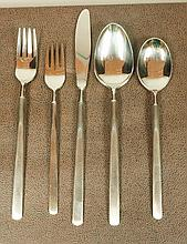 Modernist Stainless Flatware set. 8 5pc place set