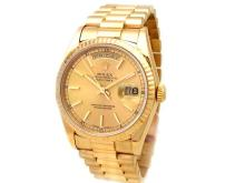36mm Gents Rolex 18k Yellow Gold Oyster Perpetual Daydate Watch. Champagne Dial. 18k Yellow Gold Fluted Bezel. 18k Yellow Gold President Band. Style 18238.