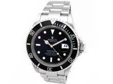 Gents Rolex Stainless Steel Oyster Perpetual Submariner Watch. Black Dial. Stainless Steel Bezel, black insert. Stainless Steel Oyster Band. Style 16610.