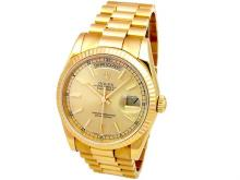 36mm Gents Rolex 18k Yellow Gold Oyster Perpetual Daydate Watch. Champagne Dial. 18k Yellow Gold Fluted Bezel. 18k Yellow Gold Oyster Band. Style 118238.