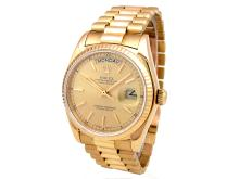 36mm Gents Rolex 18k Yellow Gold Oyster Perpetual Daydate Watch. Champagne Dial. 18K Yellow Gold Fluted Bezel. 18K Yellow Gold President Band Style 18038.