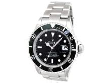 40mm Gents Rolex Stainless Steel Oyster Perpetual Submariner Watch. Black Dial. Stainless Steel Bezel, black insert. Stainless Steel Oyster Band. Style 16610.