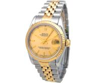31mm Rolex 18k Gold & Stainless Steel Oyster Perpetual Datejust Watch. Champagne Dial. 18k Yellow Gold Fluted Bezel. 18k Gold & Stainless Steel Jubilee Band. Style 68273.