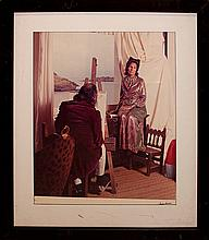 Photograph of Salvador Dali painting his wife Gala