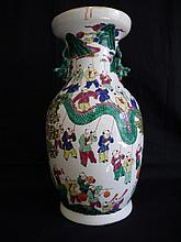 A Chinese famille-rose enamelled porcelain 'boys' trumpet neck baluster vase,