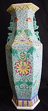 A Chinese famille-rose enamelled porcelain hexagonal baluster vase,