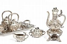 ELEGANT TEA AND COFFEE SERVICE WITH FLORAL DECOR.