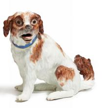 PORCELAIN FIGURE OF A SITTING DOG