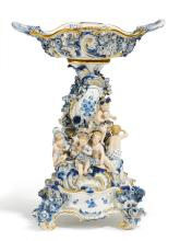 PORCELAIN CENTRE PIECE WITH THE FOUR SEASONS ON A BASE