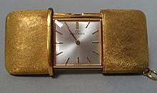 REVEIL de voyage de marque MOVADO en métal doré (vendu en l'état)