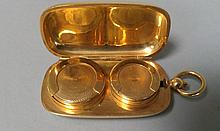 PORTE PIECES double en or jaune 18cts poids 32,8g.
