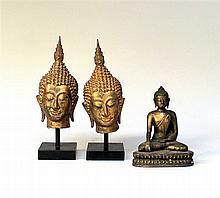Twee Thaise boeddhahoofden en een boeddha