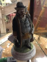 Victorian ceramic match strike in the form of a man.