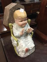 Ceramic figure of a baby.
