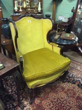Edwardian mahogany wing back chair.