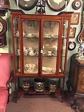 Edwardian inlaid satinwood display cabinet on tapered legs.