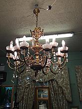 15 branch gilded metal chandelier in the empire style.