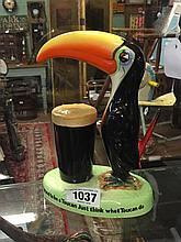 GUINNESS  Toucan lamp base by Wilshaw & Robinson.