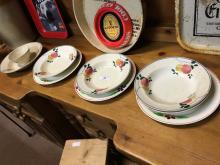 Eight late 19th C. brushware plates and a spongeware porridge bowl.