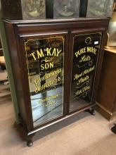 Sign painted gentlemans outfitters cabinet.