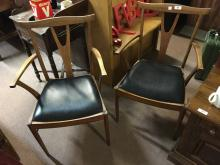 Pair of Eircol open armchairs.