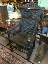 Profusely carved Victorian oak hall chair.