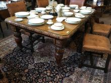 Victorian carved oak dining room table.