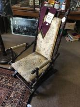 Victorian walnut rocking chair.