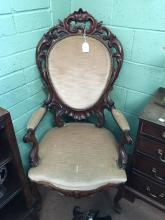 Victorian carved oak open armchair.