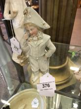 19th. C. porcelain figure of a Young Boy.