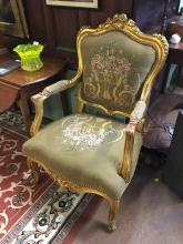 Pair of 20th. C.  gilt armchairs with tapestry upholstered seats.