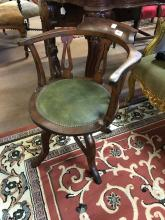 Early 20th. C. mahogany swivel office chair.