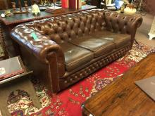 19th. C. buuton backed leather upholstered three seater chesterfield couch.