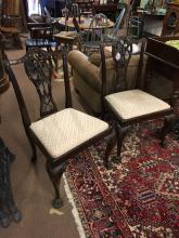 Pair of decorative mahogany chairs with ribbon carved splats in the Chippen