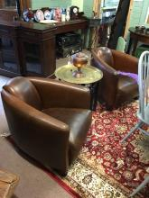 Fine quality pair of leather aviator club chairs in the Art Deco style.