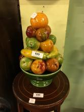 Ceramic table centre in the form of a bowl of fruit.