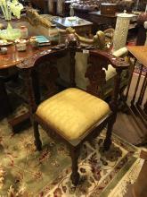 Pair of carved mahogany corner chairs.