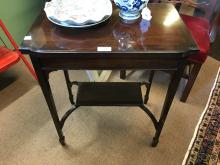 Edwardian mahogany turn over leaf card table.
