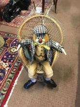 COCO Clown and wicker chair.