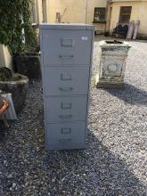 Four drawer filing cabinet.