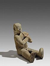 Seated warrior with nose peg (periode VI)