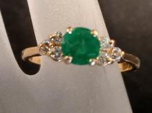 Jewelry. # 3.  14k Gold ½ ct. Emerald, .12 ct. Diamond Ring